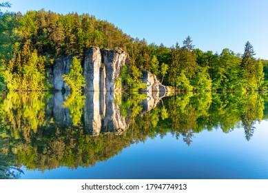 Sandstone rock towers reflected in Vezak Pond, Czech: Vezicky rybnik, Bohemian Paradise, Czech: Cesky Raj, Czech Republic. - Shutterstock ID 1794774913