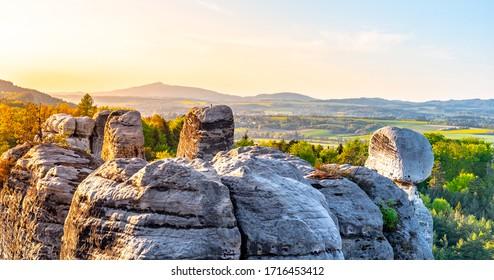 Sandstone rock town near Hruba Skala. Jested Mountain on background. Spring landscape of Bohemian Paradise, Czech: Cesky Raj. Czech Republic. - Shutterstock ID 1716453412