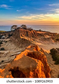 Sandstone rocks of Broken Hill at Torrey Pines State Natural Reserve and State Park La Jolla San Diego California during a beautiful sunset that illuminated the rocks