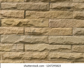 The sandstone wall is clastic sedimentary rock with grunge texture.