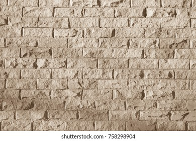 The sandstone wall is a decorative wall work as a beautiful background.