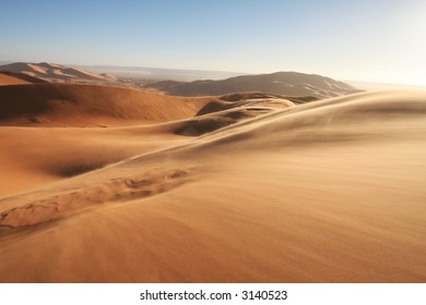 Sandstorm in Erg Chebbi sand dunes at sunrise in the Sahara Desert (Hassi Labiad and Merzouga, Morocco). Algeria is located 20 km from here.