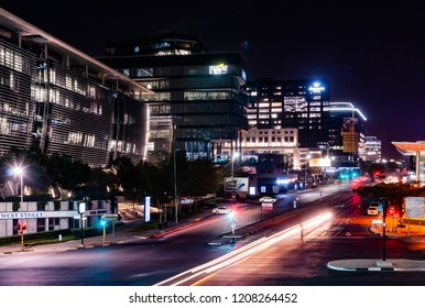 Sandton, Johannesburg Municipality, Gauteng / South Africa - June 13, 2018: downtown Sandton at night, Sandton hosted Africa Rail 2018, Africa's Largest Rail Exhibition & Conference
