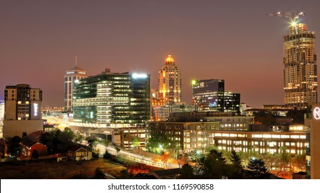 SANDTON, SOUTH AFRICA - August 25, 2018: Cityscape of the buildings in Sandton, including Sandton City, the Michelangelo Hotel, the Old Mutual headquarters and the Leonardo (under construction) -16:9