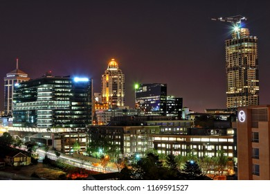 SANDTON, SOUTH AFRICA - August 25, 2018: Night cityscape of the buildings in Sandton, including Sandton City, the Michelangelo Hotel, the Old Mutual headquarters and the Leonardo (under construction)