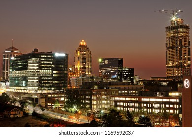 SANDTON, SOUTH AFRICA - August 25, 2018: Cityscape of the modern buildings in Sandton, including Sandton City, the Michelangelo Hotel, the Old Mutual headquarters and the Leonardo (under construction)