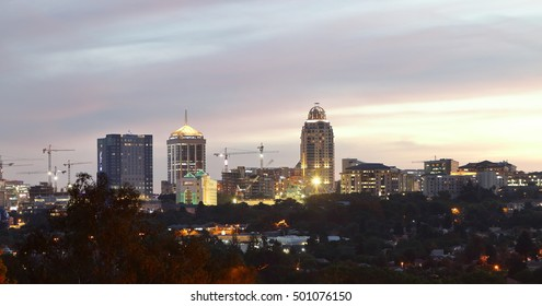 SANDTON, SOUTH AFRICA - October 5, 2016: View of the Sandton skyline including the Sandton City Shopping Mall and the Michelangelo Towers, photographed against an evening sky.