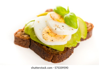 Sandwich with avocado and boiled egg isolated on white