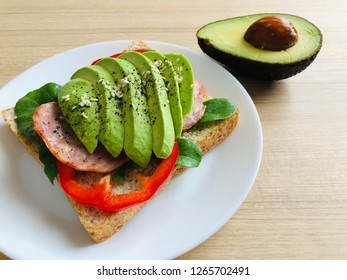 sandwich with avocado cheese and ham