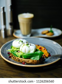 Sandwich with avocado and poached egg.Poached egg on toast. top view