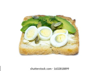 Sandwich with avocado seeds and eggs isolated on a bobl background. Front views