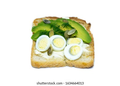 Sandwich with avocado seeds and eggs isolated on a bobl background. Top views