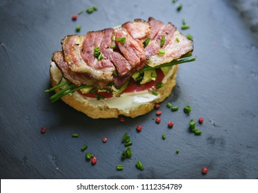 Sandwich with bacon, avocado and onion.