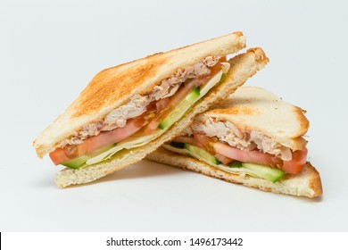 Sandwich with bacon and cucumber on white background