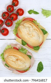 Sandwich baguette with ham and cheese from above portrait format on wooden board wood