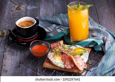 sandwich with beacon orange juice and american coffee