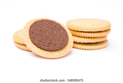 sandwich biscuits with chocolate filling on white background