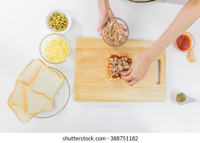 Sandwich bread, Butter and butter knife on wooden table. Top view.