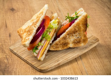 Sandwich with cheese, ham and salad