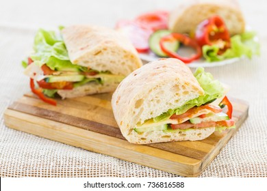 sandwich with cheese on cutting board, close-up, soft focus