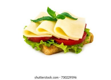 a sandwich with cheese, tomato, salad, on a white isolated background