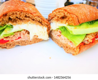 A sandwich with cheese and vegetables