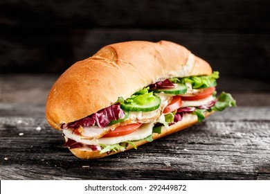Sandwich with chicken, cheese and vegetables