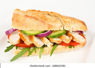 a sandwich with chicken on a plate