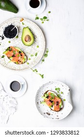 sandwich with cream cheese avocado and salmon on a light background