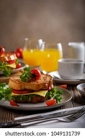 Sandwich of croutons with coffee and orange juice.