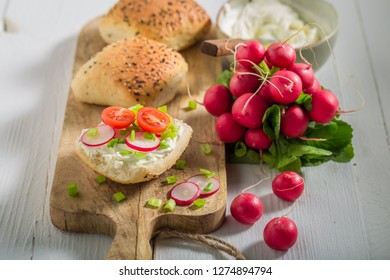 Sandwich with crunchy bread, fromage cheese and fresh radish