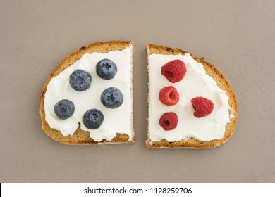 Sandwich cut in half with cream cheese and fresh fruit