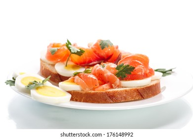 sandwich with egg and salmon on white background