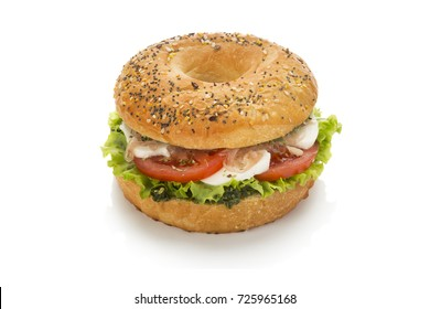 sandwich with egg and tomato and pesto sauce over white background