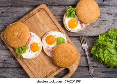 Sandwich with eggs and bacon on wooden table , top view