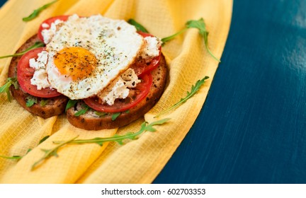 Sandwich with Feta cheese and tomatoes. Fried eggs for breakfast. Fast food, a banner for a cafe. Eating close-up.