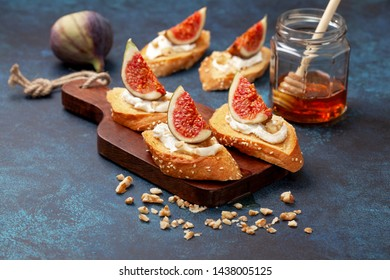 sandwich with figs, ricotta, walnuts and honey on a blue background