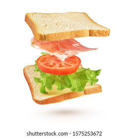 Sandwich with with flying ingredients tomato, bacon, lettuce. Isolated on white background