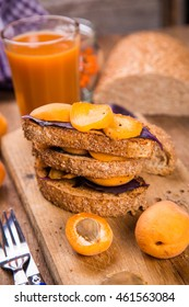 sandwich with fresh ripe raw apricot and juice on wooden background