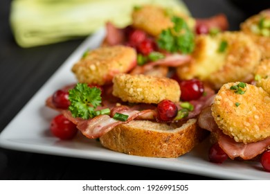 sandwich with fried camembert cheese, bacon and cranberries