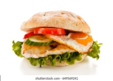 Sandwich with fried egg and chicken fillet on white background
