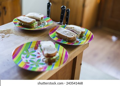 Sandwich halves on colorful plates