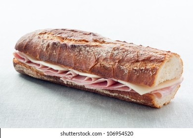 sandwich of ham and cheese on blue fabric