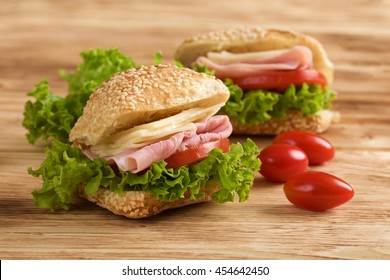 sandwich ham and cheese on wooden background