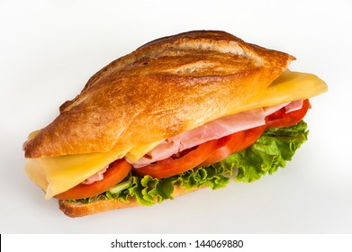 Sandwich with ham, cheese and vegetables on white