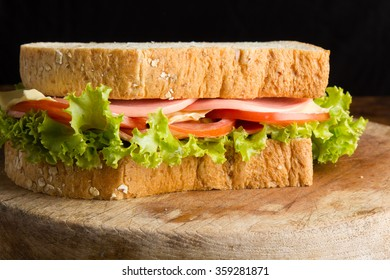 Sandwich ham cheese, whole grain bread, organic salad, cheese, fresh tomato and ham