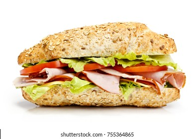 Sandwich with ham and vegetables isolated on white