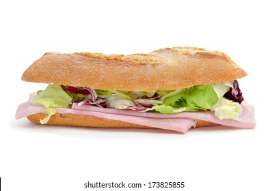 a sandwich with ham and vegetables on a white background