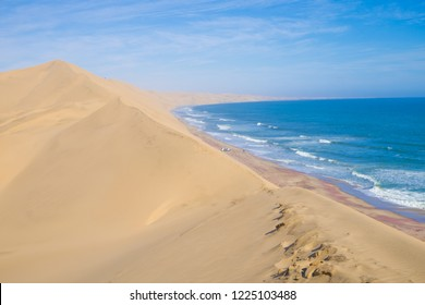 Sandwich Harbour, one of the few places in the world where giant sand dunes run straight into the ocean, Namibia.