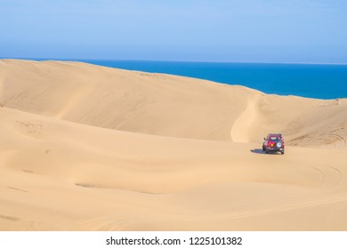 Sandwich Harbour/Namibia: June 10, 2018: Desert safari in Sandwich Harbour, one of the few places in the world where giant sand dunes run straight into the ocean.